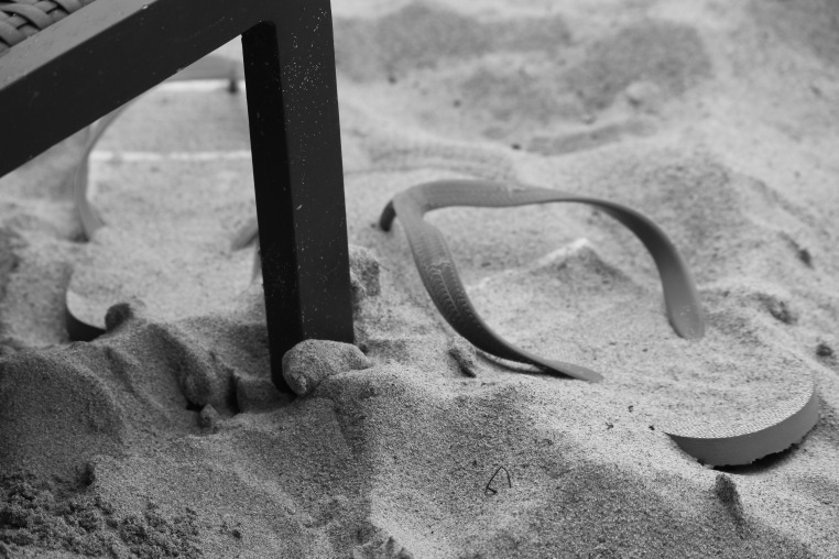 Even flip flops want frolic in the sand